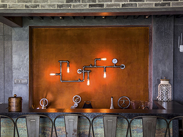 Rust finished highlighter wall for a bar area in a villa in aamby valley, Mumbai, by Evolve India special finishes